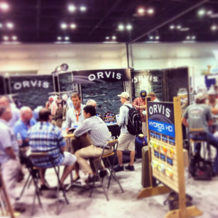 The Orvis booth in full-on work mode, IFTD 2014.