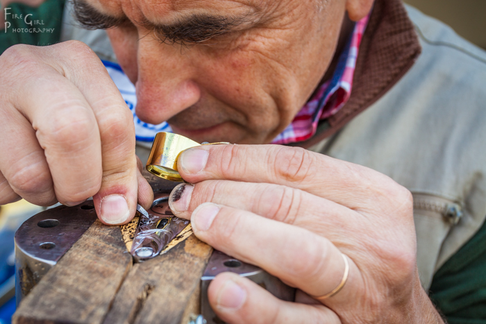 Geoffroy Gournet, master engraver, working on a piece in the marketplace.
