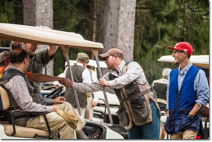 Shaking hands before the start of the sporting clays competition.