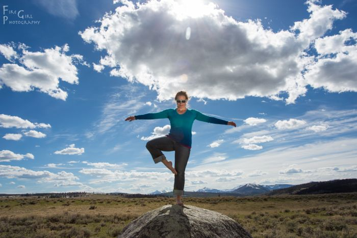 Photo assistant extraordinaire Jenny moves into tree pose in Yellowstone.